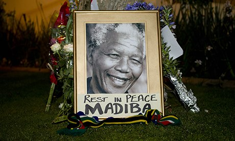 Tributes to former President Nelson Mandela's outside his home in Houghton, Johannesburg
